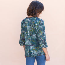 back view of teal little journeys blouse