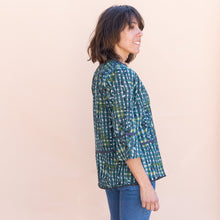 side view of teal little journeys blouse