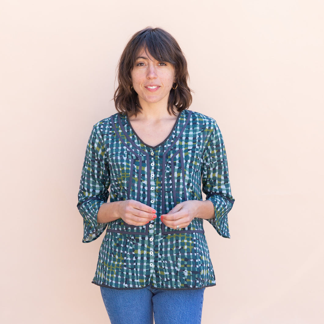 front view of teal little journeys blouse