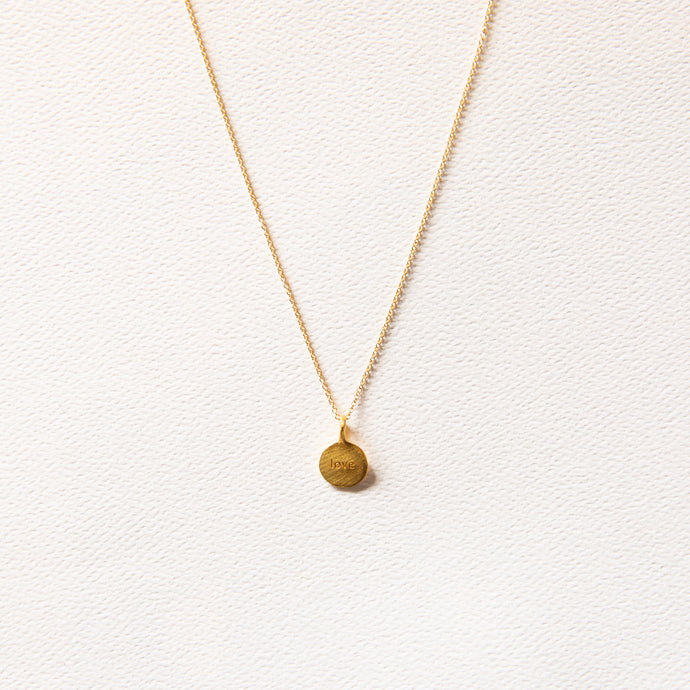 front view of gold love necklace
