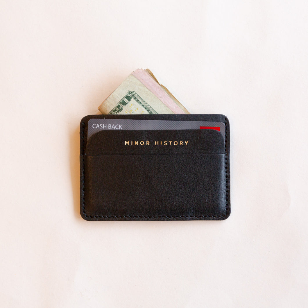 black card holder with cash