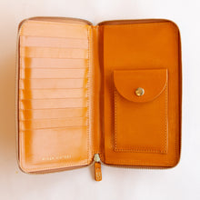 inside of zip-around wallet in cognac