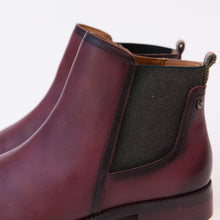 close up view garnet leather boot from spain