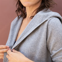 close up view hooded cardigan by swtr