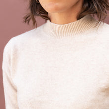 close up view mock neck sweater in cream by swtr