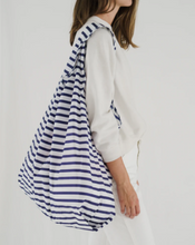 Load image into Gallery viewer, baggu big reusable bag sailor stripe slung over model's shoulder on white background