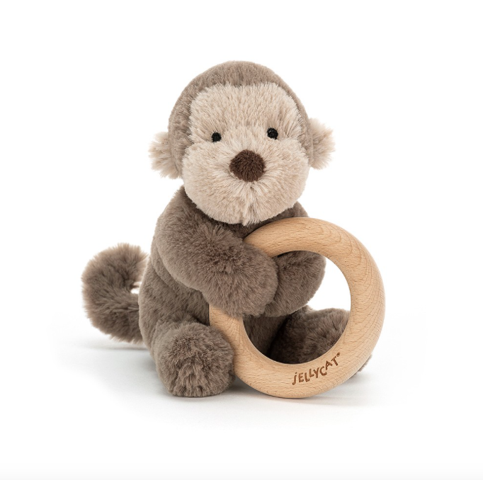 jellycat monkey ring toy sitting down front view with white background