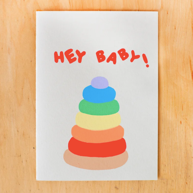 gold teeth brooklyn  hey baby card laydown top view on wooden background