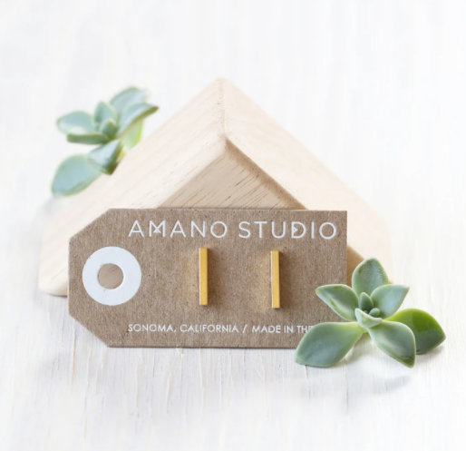 amano studio gold bar stud earrings laid out in packaging