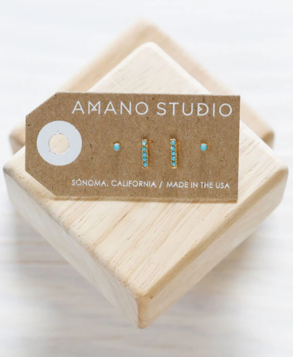 amano stud set turquoise laydown on wooden block in card backing