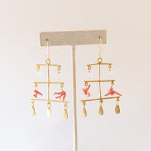 front view of rising sea earrings