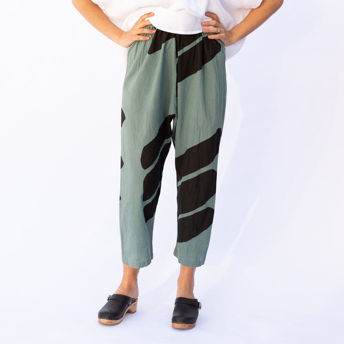 front view uzi pant in teal & black