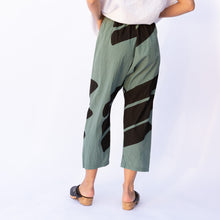 back view uzi pant in teal & black