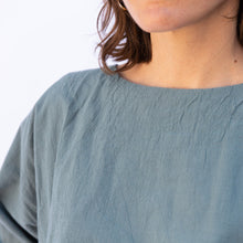 close up view uzi tunic in teal
