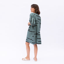 diagonal back view of teal uzi tunic