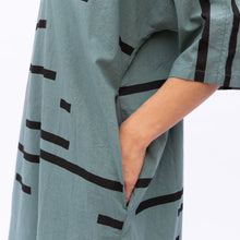 pocket detail of teal uzi tunic