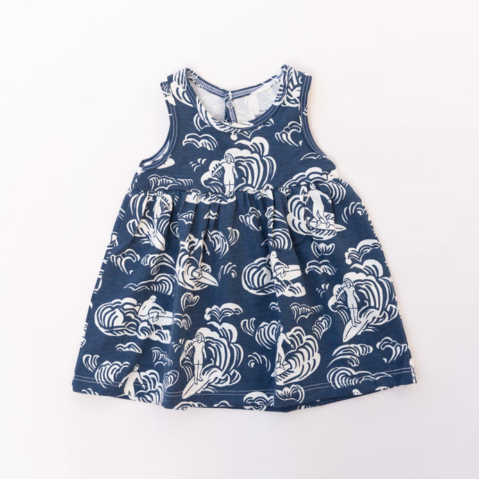 front view of oslo baby dress in navy surfer print