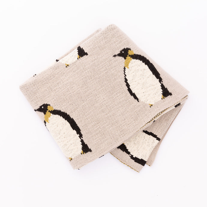 front view of woven penguin blanket