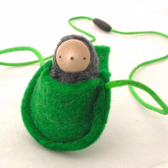 Front view of small grey mole tucked into its green felt pouch
