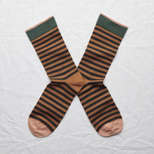 Load image into Gallery viewer, Mid- calf sock pair lying heel to heel in dark stripe on caramel background with spruce green rib trimming and chestnut brown toe & edging.