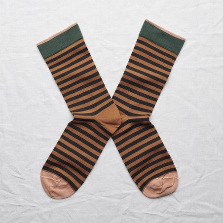 Mid- calf sock pair lying heel to heel in dark stripe on caramel background with spruce green rib trimming and chestnut brown toe & edging.