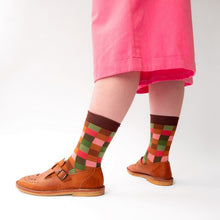 Close up shot of the brown checkered socks worn under pink culottes with chestnut brown Mary Jane shoes.