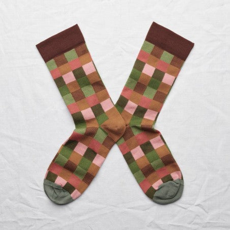 Photo shows a pair of mid-calf socks in caramel brown, wilted red, peach pink, cactus green with a cedar green toe.