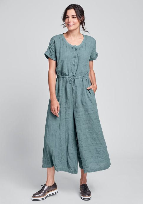 front view of Flax's linen jumpsuit in a teal color called jade.