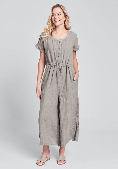 front view of Flax's linen jumpsuit in a grey color called stone