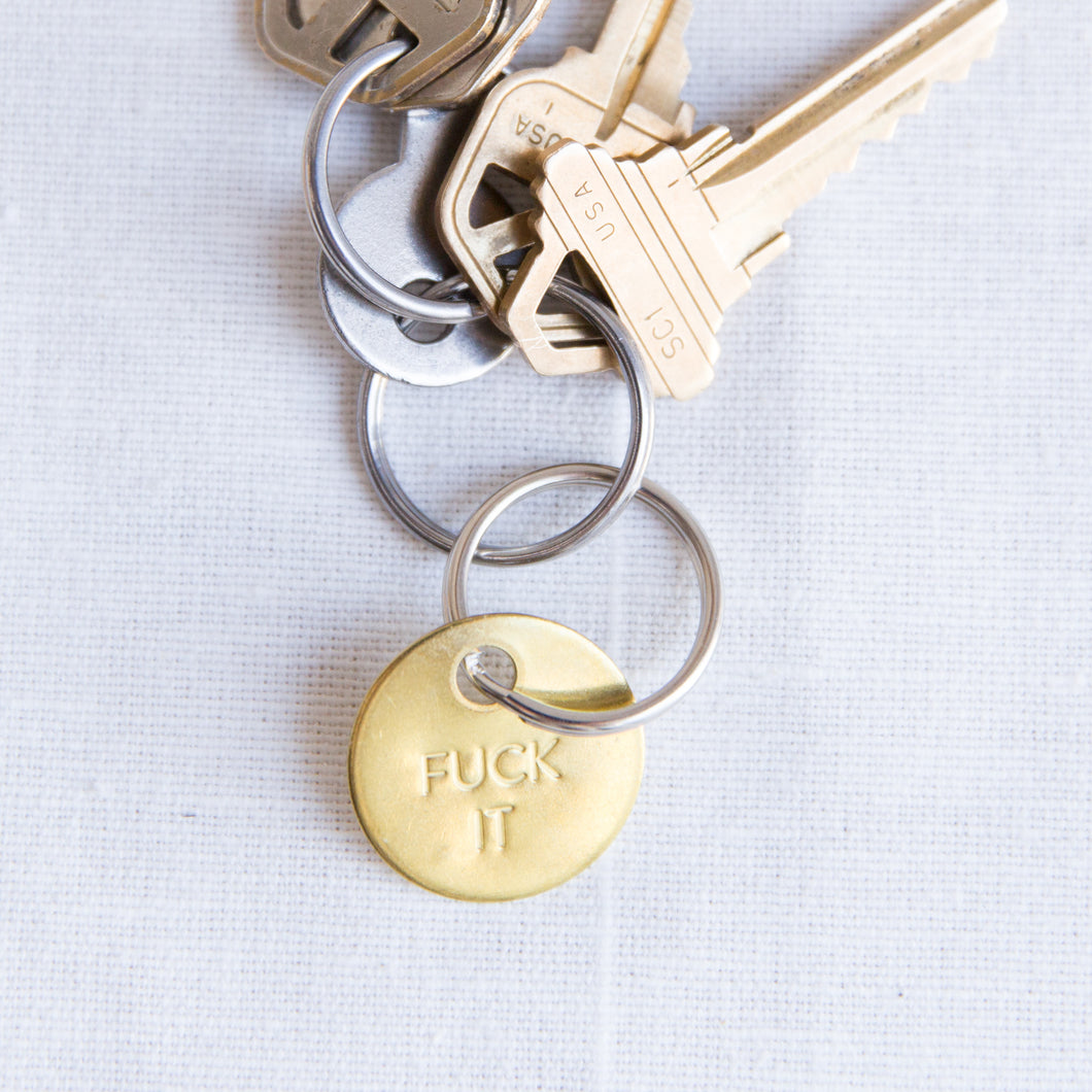 brass fuck it keychain with keys from los angeles
