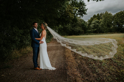 Bride in long lace edged veil