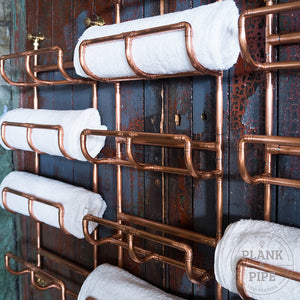 Close up of copper Towel Rack holding towels