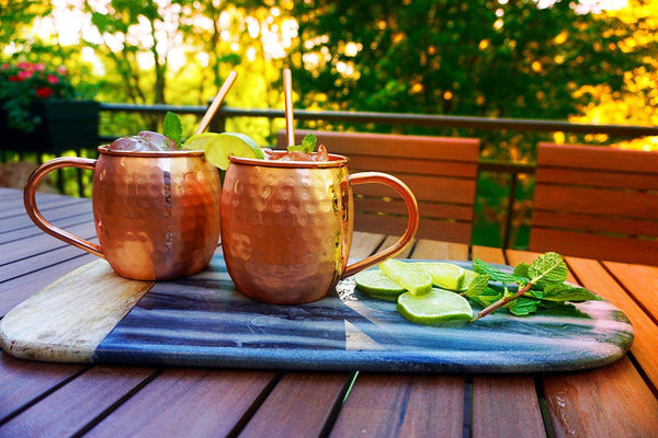 Thirsty Mules - Set of 2 Hand Crafted Copper Moscow Mule Mugs - Large 20 oz. Mugs on table