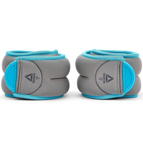 Reebok Ankle Weights 1Kg x 2 ( RAWT-11074BL )  https://thesweatshop.club/products/reebok-ankle-weights-1kg-x-2-rawt-11074bl  Helping to ramp up your workouts, Reebok Ankle Weights enhances bodyweight movements for more challenging training sessions. Comfortable, adjustable & secure, the pair of 1kg grey and blue ankle weights fit securely on the ankles thanks to their easily adjustable hook and loop closure. Buy online India.COD AVAILABLE.A