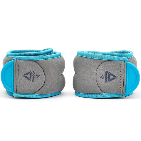 Reebok Ankle Weights 0.5Kg x 2 ( RAWT-11073BL )  https://thesweatshop.club/products/reebok-ankle-weights-0-5kg-x-2-rawt-11073bl  Helping to ramp up your workouts, Reebok Ankle Weights enhances bodyweight movements for more challenging training sessions. Comfortable, adjustable & secure, the pair of 0.5kg grey and blue ankle weights fit securely on the ankles thanks to their easily adjustable hook and loop closure. Buy online India.COD AVAILABLE.a