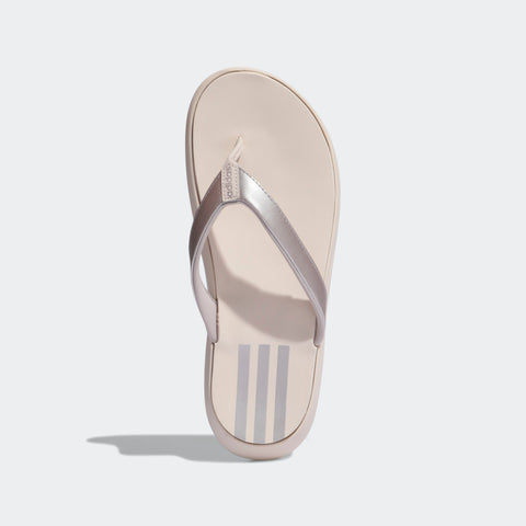 ADIDAS WOMEN'S COMFORT FLIP FLOP (EG2057, PLATINUM METALLIC / LINEN / …  https://thesweatshop.club/products/adidas-womens-comfort-flip-flop-eg2057-platinum-metallic-linen-linen  ADIDAS SANDALS FOR COMFORTABLE STRIDES. Enjoy sunny days in the sand or on the pool deck. These thong sandals pamper your feet with a plush, quick-drying footbed. A rugged outsole delivers durability while the contrasting 3-Stripes provide a sporty look. .Buy online India.COD available.C