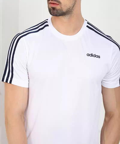 ADIDAS MEN'S CLASSIC 3 STRIPES SPORT TEE - White/Black  https://thesweatshop.club/products/copy-of-adidas-mens-athletics-3-badge-of-sport-camouflage-tee  ADIDAS MEN'S CLASSIC 3 STRIPES WHITE/BLACK TEE Style that goes from practice to the street. Contrast 3-Stripes on the sleeves of this men's t-shirt give it a sporty authentic touch. The tee is made of polyester single jersey fabric for a soft feel.BUY ONLINE INDIA.COD AVAILABLE.C