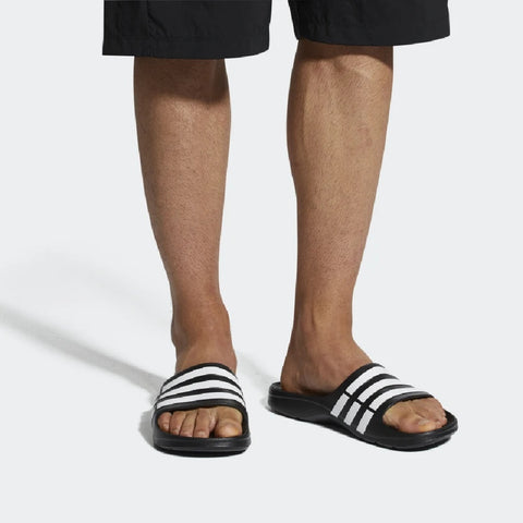 Adidas Men's Essentials Duramo Slides DURAMO SLIDES MINIMALIST SLIDES THAT CAN BE WORN ANYWHERE. .Buy online India a