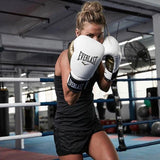 The Everlast PowerLock Boxing Training Gloves were designed with a modern, anatomical foam construction that guides your hand into a natural fist position. Colour White / Gold. Available in 10oz, 12oz & 14oz. Shop India online. COD available. c