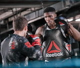 Constructed from heavy-duty leather, the Reebok Combat Focus Pads feature a densely padded curved strike zone for optimal comfort and shock absorption. Buy online India.COD available k
