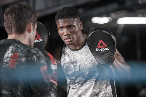 Constructed from heavy-duty leather, the Reebok Combat Focus Pads feature a densely padded curved strike zone for optimal comfort and shock absorption. Buy online India.COD available a