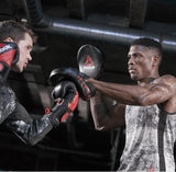 Constructed from heavy-duty leather, the Reebok Combat Focus Pads feature a densely padded curved strike zone for optimal comfort and shock absorption. Buy online India.COD available j