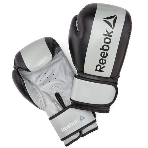 Reebok Boxing Gloves - Grey : Spar in Reebok style. Safe, durable and long lasting, the grey gloves offer the right amount of protection for bag work, sparring and other types of combat training a