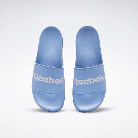 REEBOK CLASSIC SLIDES ( EH3051, CORNFLOWER BLUE / LILAC FROST / CORNFL…  https://thesweatshop.club/products/reebok-classic-slides-eh3051-cornflower-blue-lilac-frost-cornflower-blue  REEBOK CLASSIC SLIDES SPORTY SLIDES WITH A SUMMER-INSPIRED STYLE Go from beach to street. These easygoing slides slip on for a laid-back vibe. Buy online India.Cod Available.C