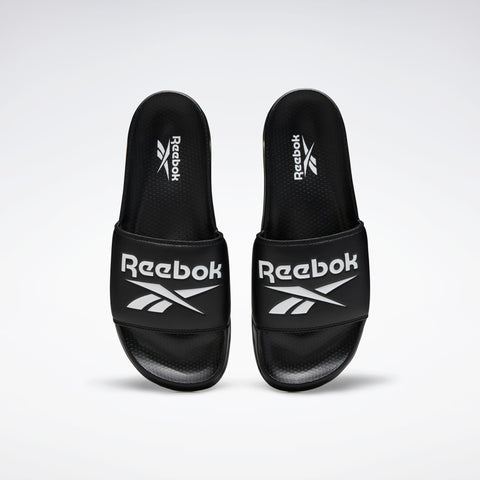 REEBOK CLASSIC SLIDES ( EH0667, BLACK / WHITE / BLACK )  https://thesweatshop.club/products/reebok-classic-slides-eh0667-black-white-black  REEBOK CLASSIC SLIDES SPORTY SLIDES WITH A SUMMER-INSPIRED STYLE Go from beach to street. These easygoing slides slip on for a laid-back vibe. Buy online India.Cod Available.d