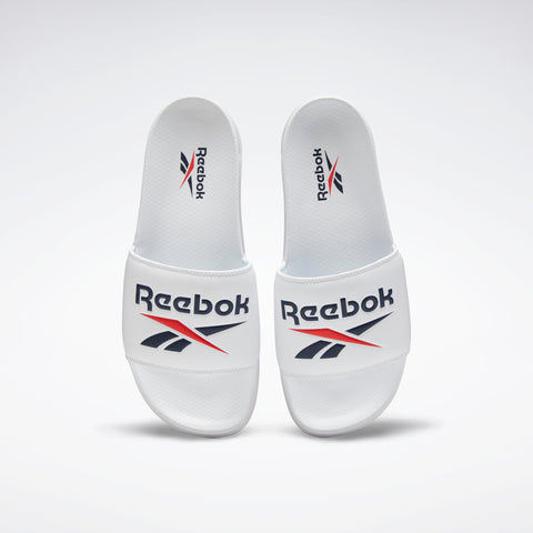 REEBOK CLASSIC SLIDES ( EH0668, WHITE / COLLEGIATE NAVY / RADIANT RED …  https://thesweatshop.club/products/reebok-classic-slides-eh0668-white-collegiate-navy-radiant-red  REEBOK CLASSIC SLIDES SPORTY SLIDES WITH A SUMMER-INSPIRED STYLE Go from beach to street. These easygoing slides slip on for a laid-back vibe. Buy online India.Cod Available.c