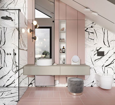 This pink and monochrome bathroom design has a grey unit that is wall mounted in front of a full length mirror, and lit by glamorous bathroom vanity lights.