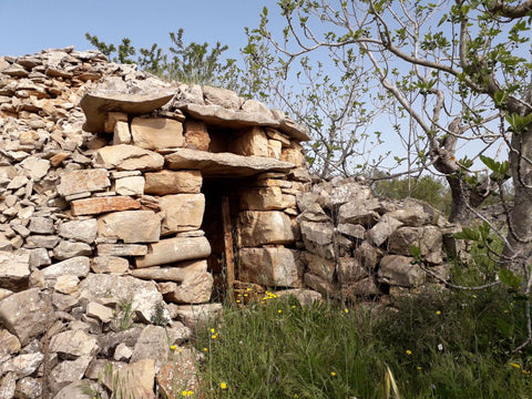 A trullo (plural, trulli) is a traditional Apulian dry stone hut with a conical roof