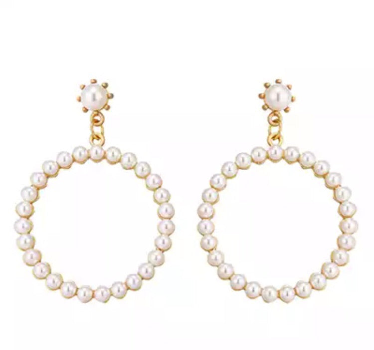 pearl disc statement earrings