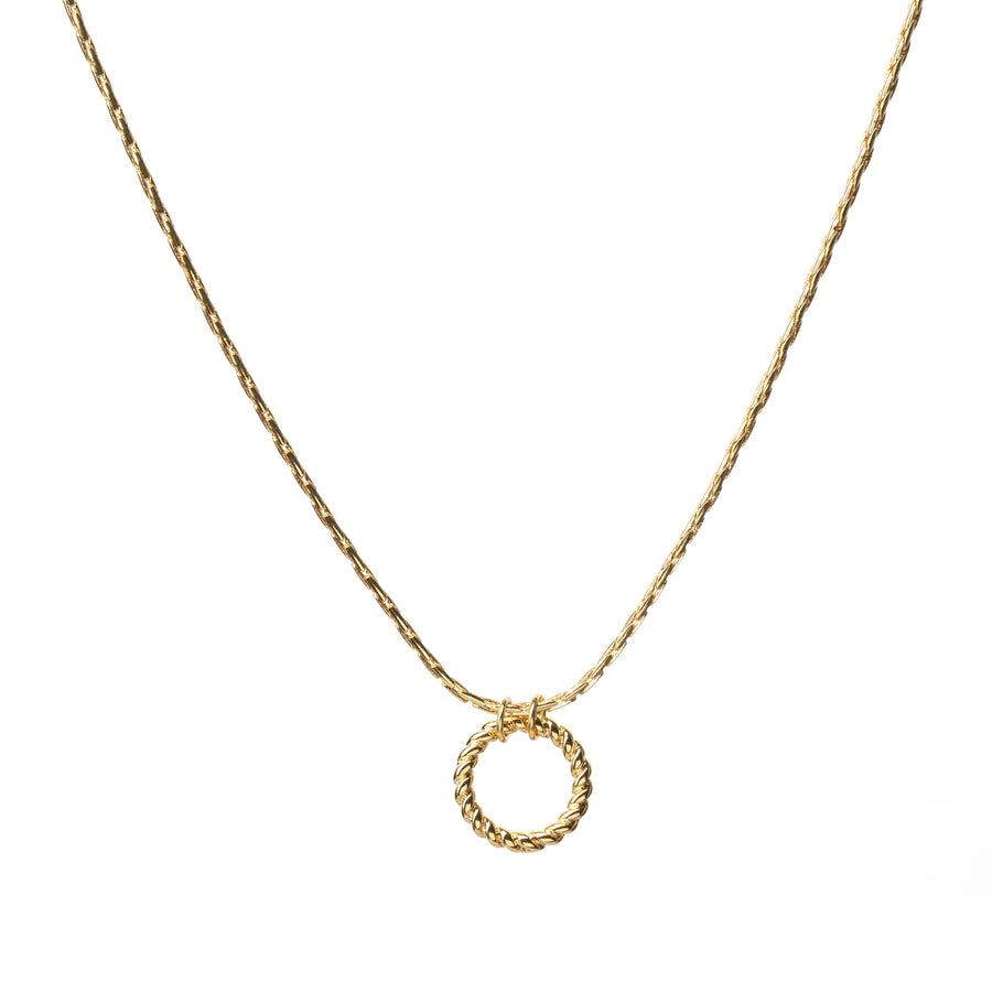 Gold circle necklace on a textured chain